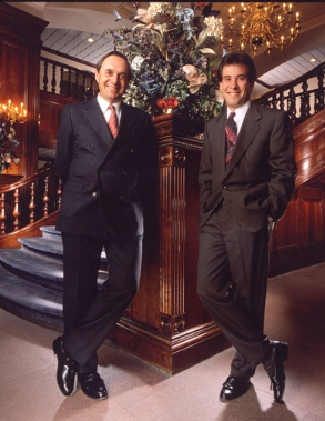 Two guys in front of staircase in suites.