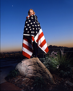 Woman with American Flag wrapped around her.